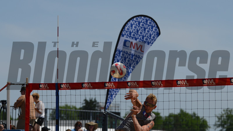 Casey Patterson spiking the ball during warmups before the NVL volleyball tournament in the 2012 Preakness infield