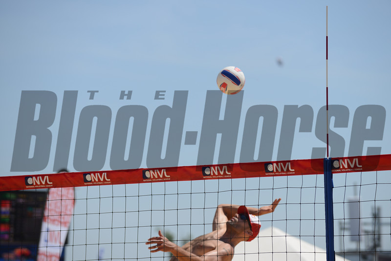 2008 Olympic  gold medalist Phil Dalhausserat goes for a spike at the NVL final tournament game in the 2012 Preakness infield