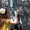 A young girl enjoys the graffiti wall at Pimlico Racecourse on May 19, 2012.