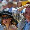 John Campbell shows both sides of betting on Preakness Day at Pimlico Race Course in Baltimore, MD May 18, 2012.