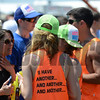 Infield scene with fans wearing shirts showcasing I'll Have Another in the Preakness infield, 2012