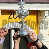 Doug O'Neill, holds the winner's trophy aloft after his trainee I'll Have Another won the 137th running of The Preakness Stakes at Pimlico in Baltimore, MD. May 19, 2012.    Skip Dickstein Photo