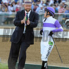 Trainer Doug O'Neill giving jockey Mario Gutierrez instructions before the Preakness...<br /> © 2012 Rick Samuels/The Blood-Horse
