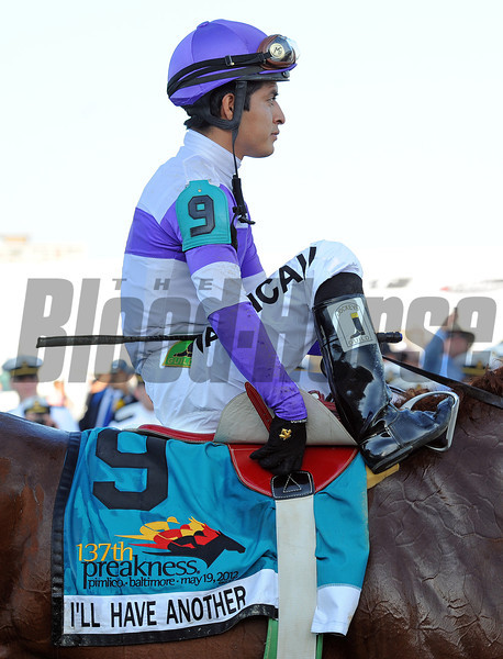 Jockey Mario Gutierrez on his way to the winners' circle...<br /> © 2012 Rick Samuels/The Blood-Horse