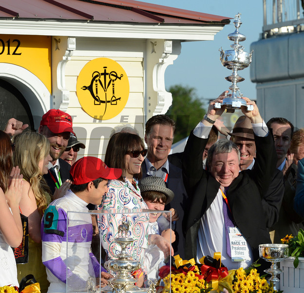Paul Reddam holds the winner's trophy aloft after his horse I'll Have Another won the 137th running of The Preakness Stakes at Pimlico in Baltimore, MD. May 19, 2012.    <br /> Skip Dickstein Photo