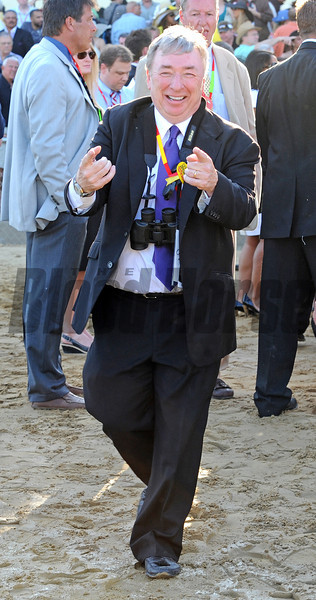 J. Paul Reddam owner of I'll Have Another, on his way to the winners' circle after the Preakness...<br /> © 2012 Rick Samuels/The Blood-Horse