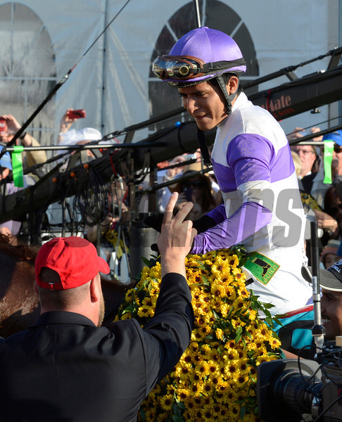 Mario Gutierrez sits atop I'll Have Another and celebrates with trainer Doug O'Neill after beating Bodemeister with Mike Smith to the win the 137th running of The Preakness Stakes at Pimlico in Baltimore, MD. May 19, 2012.     <br /> (Skip Dickstein Photo)