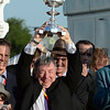 Owner J. Paul Reddam holds the winner's trophy aloft after his horse I'll Have Another won the 137th running of The Preakness Stakes at Pimlico in Baltimore, MD. May 19, 2012.    Skip Dickstein Photo