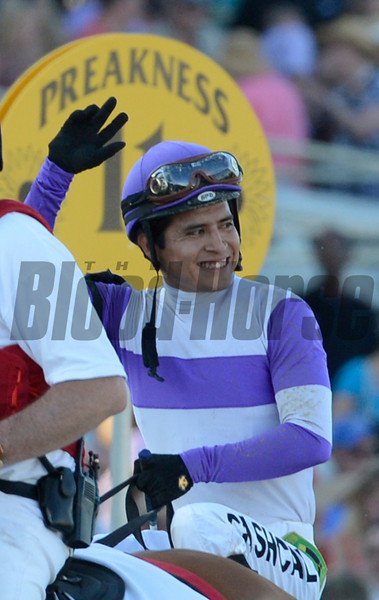 Mario Gutierrez sits atop I'll Have Another and celebrates after beating Bodemeister with Mike Smith to the win the 137th running of The Preakness Stakes at Pimlico in Baltimore, MD. May 19, 2012.     <br /> Skip Dickstein Photo