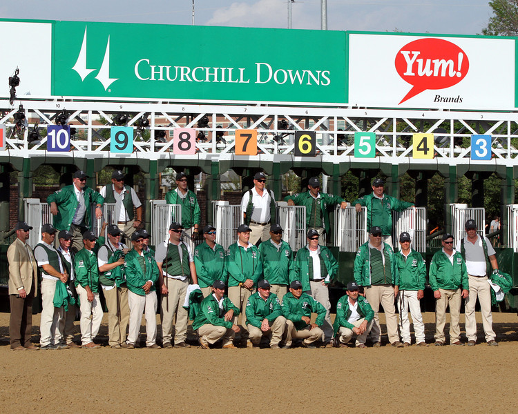 The starting gate crew prior to the running of the 138th Kentucky Derby at Churchill Downs on May 5, 2012.<br /> Photo by Chad Harmon.
