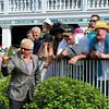 Caption:  Chef Guy Fieri (with show Diners, Drive-Ins, and Dives) mugs for the camera with fans by the paddock.<br /> <br /> Kentucky Derby presented by Yum at Churchill Downs near Louisville, Ky. on May 5, 2012.<br /> <br /> Photo by Anne M. Eberhardt