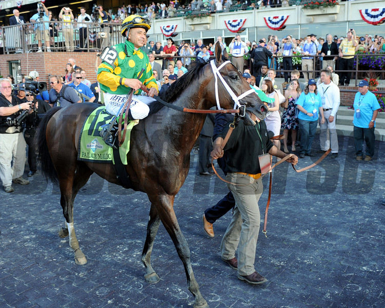Palace Malice and Mike Smith are circled in the Belmont Park winner's circle.<br /> Dave Harmon Photo