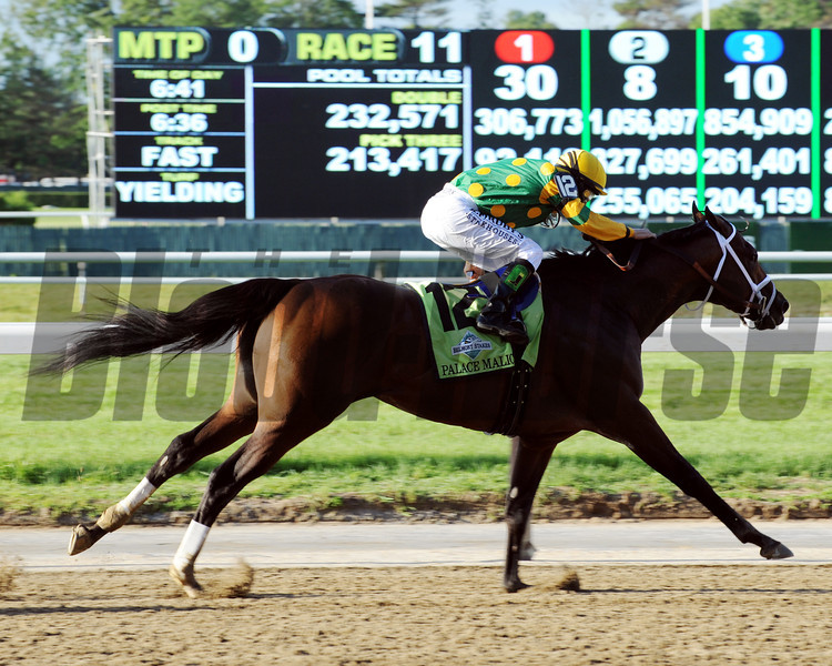 Palace Malice stretches out in the final strides of the Belmont Stakes.<br /> Dave Harmon Photo