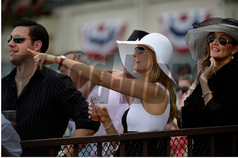 A woman points out the horse she bet on at the Belmont Race Course in Belmont Stakes Day June 8, 2013.  Photo by Skip Dickstein