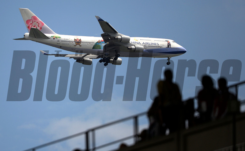 A China Airways plane flies over the Belmont Race Course in Belmont Stakes Day June 8, 2013.  Photo by Skip Dickstein