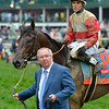 Orb is lead to the winner's circle by his trainer Shug McGaughey after winning 139th edition of the Kentucky Derby with jockey Joel Rosario in the irons and it gave trainer Shug McGaughey his first win in the classic May 4, 2013 at Churchill Downs in Louisville, Kentucky.<br /> Skip Dickstein Photo