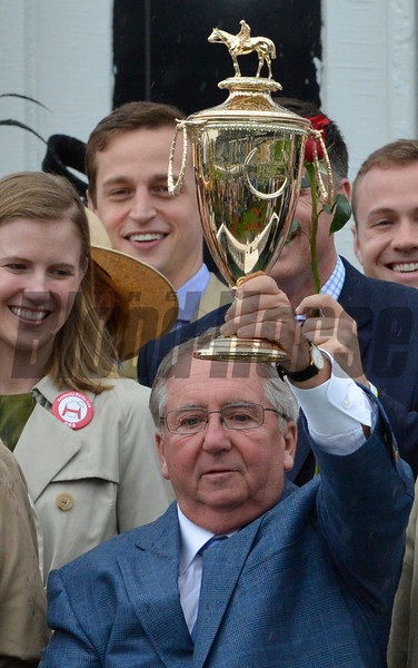 Trainer Shug McGaughey holds the winner's trophy after Orb won the 139th running of the Kentucky Derby May 4, 2013 at Churchill Downs in Louisville, Kentucky.