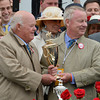 "Co-owners and breeders Ogden Mills ""Dinny"" Phipps, left, and Stuart Janney hold the winner's trophy after Orb won the 139th running of the Kentucky Derby May 4, 2013 at Churchill Downs in Louisville, Kentucky.<br /> Skip Dickstein Photo"