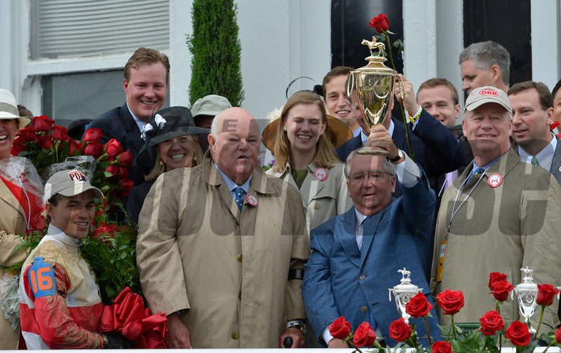 "Trainer Shug McGaughey holds the winner's trophy after Orb won the 139th running of the Kentucky Derby May 4, 2013 at Churchill Downs in Louisville, Kentucky.  He is flanked by co-owners Ogden Mills ""Dinny"" Phipps, second from left and Stuart Janney, right and jockey Joel Rosario on the left.<br /> Skip Dickstein Photo"