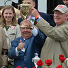 Trainer Shug McGaughey and owner Stuart Janney hold the winner's trophy after Orb won the 139th running of the Kentucky Derby May 4, 2013 at Churchill Downs in Louisville, Kentucky.<br /> Skip Dickstein Photo