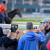 Caption:  trainer Doug O'Neill, right, talks with reporters by the track<br /> works and scenes at Churchill Downs near Louisville, Ky. on April 28, 2013, during Kentucky Derby and Kentucky Oaks week.<br /> 3Works4_28_13 image504<br /> Photo by Anne M. Eberhardt