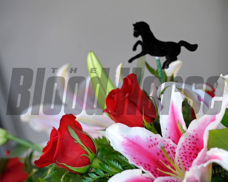 Caption:  Oaks Lillies and Derby roses in an arrangement<br /> works and scenes at Churchill Downs near Louisville, Ky. on April 30, 2013, during Kentucky Derby and Kentucky Oaks week.<br /> 2Works4_30_13 image0001<br /> Photo by Anne M. Eberhardt