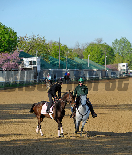 Caption: Close Hatches with Jo Lawson stays with the pony until she starts her work.<br /> Morning scenes at Churchill Downs near Louisville, Ky., on April 21, 2013.<br /> 1Works4_21_13 image237<br /> Photo by Anne M. Eberhardt