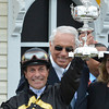 Gary Stevens and trainer D. Wayne Lukas hold the winner's trophy after Oxbow with Gary Stevens aboard won the 138th running of the Preakness Stakes at Pimlico in Baltimore, Maryland May 18, 2013.  Photo by Skip Dickstein
