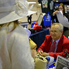 Caption: Ron Turcotte signing autographs and talking with fans at Secretariat booth.<br /> Preakness week 2013 with Preakness horses and other going to the track at Pimlico on May 17, 2013, in Baltimore, Md.<br /> PREAKNESS Scenes1  image700<br /> Photo by Anne M. Eberhardt