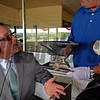 Darren Rogers with Churchill Downs arrived with the Triple Crown trophy during the Steve Byk show with And They're Off's  Steve Haskin, on right, on Wed. June 4, 2014, at Belmont Park, in Elmont, NY.<br /> iphonephotos image 1560<br /> Photo by Anne M. Eberhardt