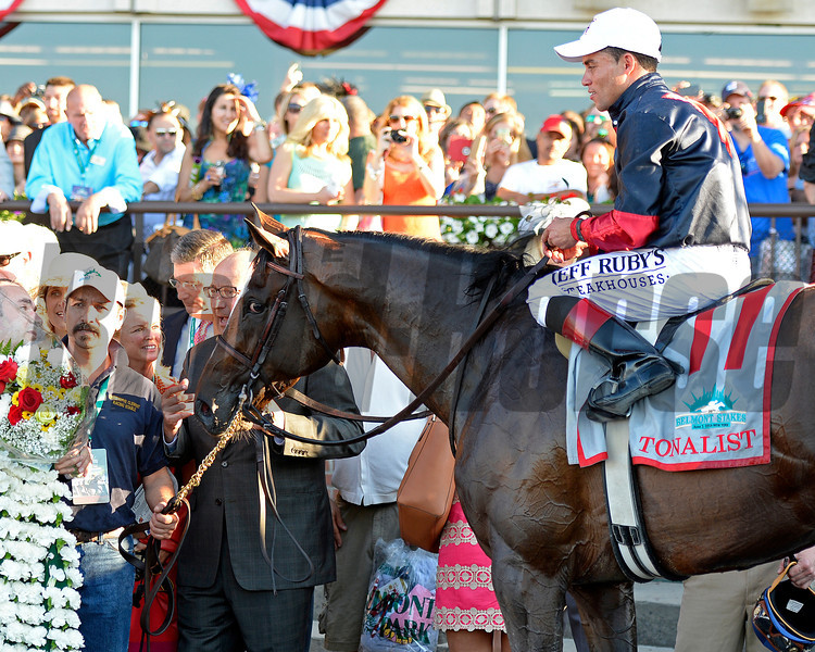 Caption: Tonalist with Joel Rosario. Trainer Christophe Clement holds Tonalist<br /> wins the Belmont Stakes (gr. I) on June 7, 2014, at Belmont Park in Elmont, N.Y.<br /> 11-Belmont1 image930<br /> Photo by Anne M. Eberhardt