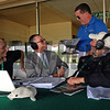Darren Rogers with Churchill Downs arrived with the Triple Crown trophy during the Steve Byk show with And They're Off's own Lenny SHulman, left, and Steve Haskin, on Wed. June 4, 2014, at Belmont Park, in Elmont, NY.<br /> iphonephotos image 1560<br /> Photo by Anne M. Eberhardt