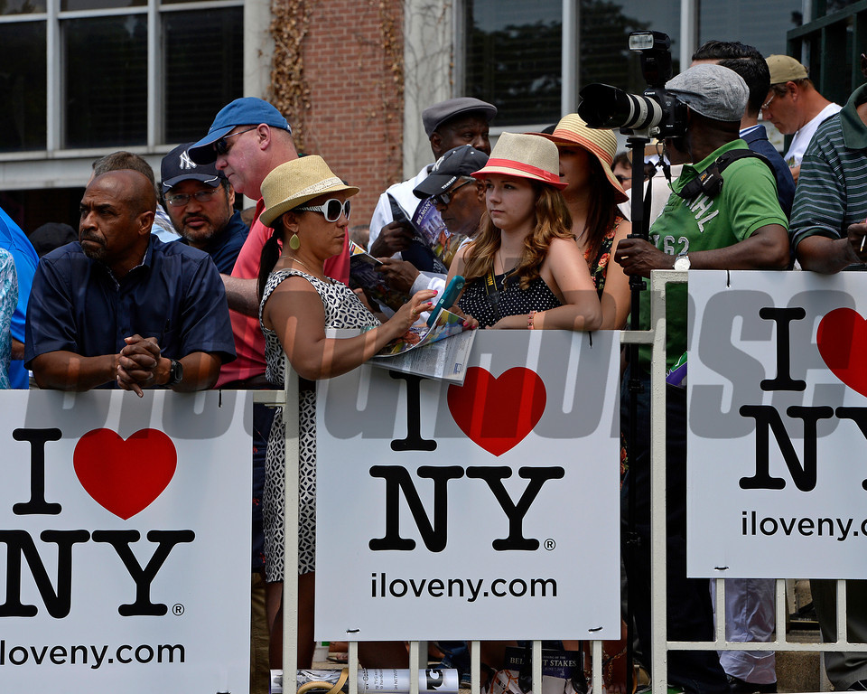Caption: fans behind I Love NY signs<br /> Belmont Stakes day on June 7, 2014, at Belmont Park in Elmont, N.Y.<br /> 3-Brooklyn1 image541<br /> Photo by Anne M. Eberhardt