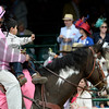 An outrider takes his child for ride in front of the race fans May 2, 2014 at Churchill Downs Race Track, the home of the 140th running of the Kentucky Derby to be run tomorrow in Louisville, Kentucky   (Skip Dickstein / Times Union)