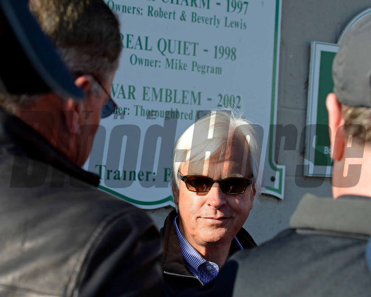 Caption: trainer Bob Baffert at barn surrounded by media<br /> Kentucky Derby contenders in training at the Churchill Downs in Louisville, Ky., on April 19, 2014.<br /> KentuckyDerby 2Works4_23 image281<br /> Photo by Anne M. Eberhardt