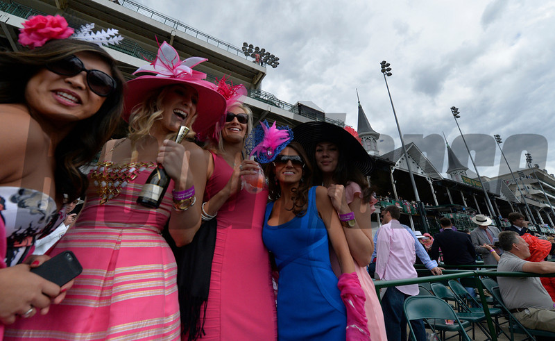 Local friends from left to right; Kimberly Mello, Jacqueline LaFond, Maria Ellis, Maggie McKinley and Lindsey Braun all of Louisville show off her pink colored hat in honor of Brest and Ovarian Awareness Day May 2, 2014 at Churchill Downs Race Track, the home of the 140th running of the Kentucky Derby to be run tomorrow in Louisville, Kentucky   (Skip Dickstein
