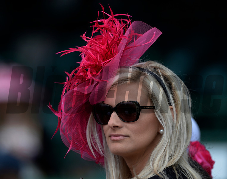 Maria Ellis of Louisville shows off her pink colored hat in honor of Brest and Ovarian Awareness Day May 2, 2014 at Churchill Downs Race Track, the home of the 140th running of the Kentucky Derby to be run tomorrow in Louisville, Kentucky   (Skip Dickstein / Times Union)