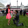 "Jordan Lorch 22 received a marriage proposal from Alex Swoboda both of Louisville this afternoon May 2, 2014 in the paddock of Churchill Downs Race Track in Louisville, Kentucky.  Jordan said ""yes"". (Skip Dickstein / Times Union)"