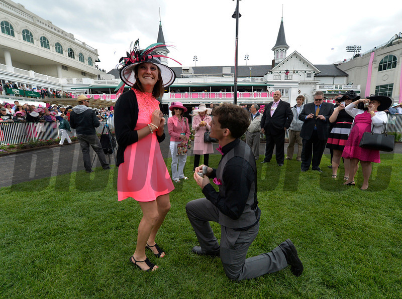 """Jordan Lorch 22 received a marriage proposal from Alex Swoboda both of Louisville this afternoon May 2, 2014 in the paddock of Churchill Downs Race Track in Louisville, Kentucky.  Jordan said """"yes"""". (Skip Dickstein / Times Union)"""