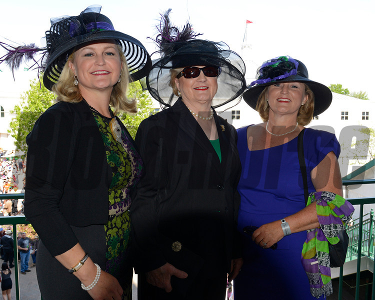 Caption: California Chrome fans and relations of California Chrome.<br /> Kentucky Oaks day at Churchill Downs in Louisville, Ky., on May 3, 2014<br /> PreDerby1  image421<br /> Photo by Anne M. Eberhardt