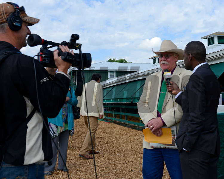 Caption: Ken Rudolph with Sacramento television crew interviews California Chrome owner Steve Coburn.<br /> Scenes at Pimlico  in Baltimore, Md., on May 17, 2014.<br /> Scenes3  image505<br /> Photo by Anne M. Eberhardt
