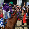 Jockey Victor Espinoza jumps up in saddle after guiding California Chrome to the win in the second leg of thoroughbred racing's Triple Crown with his win in the 139th running of The Preakness Stakes Saturday evening May 17, 2014 at Pimlico Race Course in Baltimore, Maryland.      (Skip Dickstein