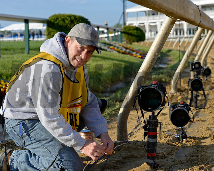 Caption: Tim Lanahan with Blood-Horse Publications, sets camera remotes for the Preakness finish.<br /> Scenes at Pimlico  in Baltimore, Md., on May 17, 2014.<br /> Scenes2  image196<br /> Photo by Anne M. Eberhardt