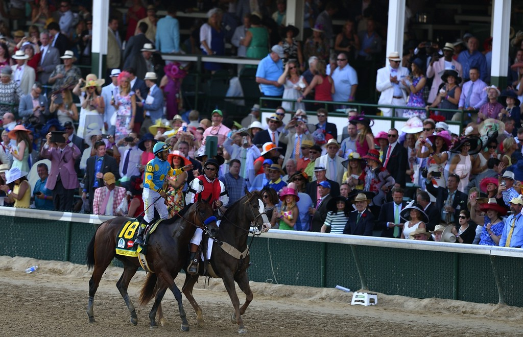 Victor Espanosa Celebrating aboard American Pharoah after winnig the 141st Running of the Kentucky Derby
