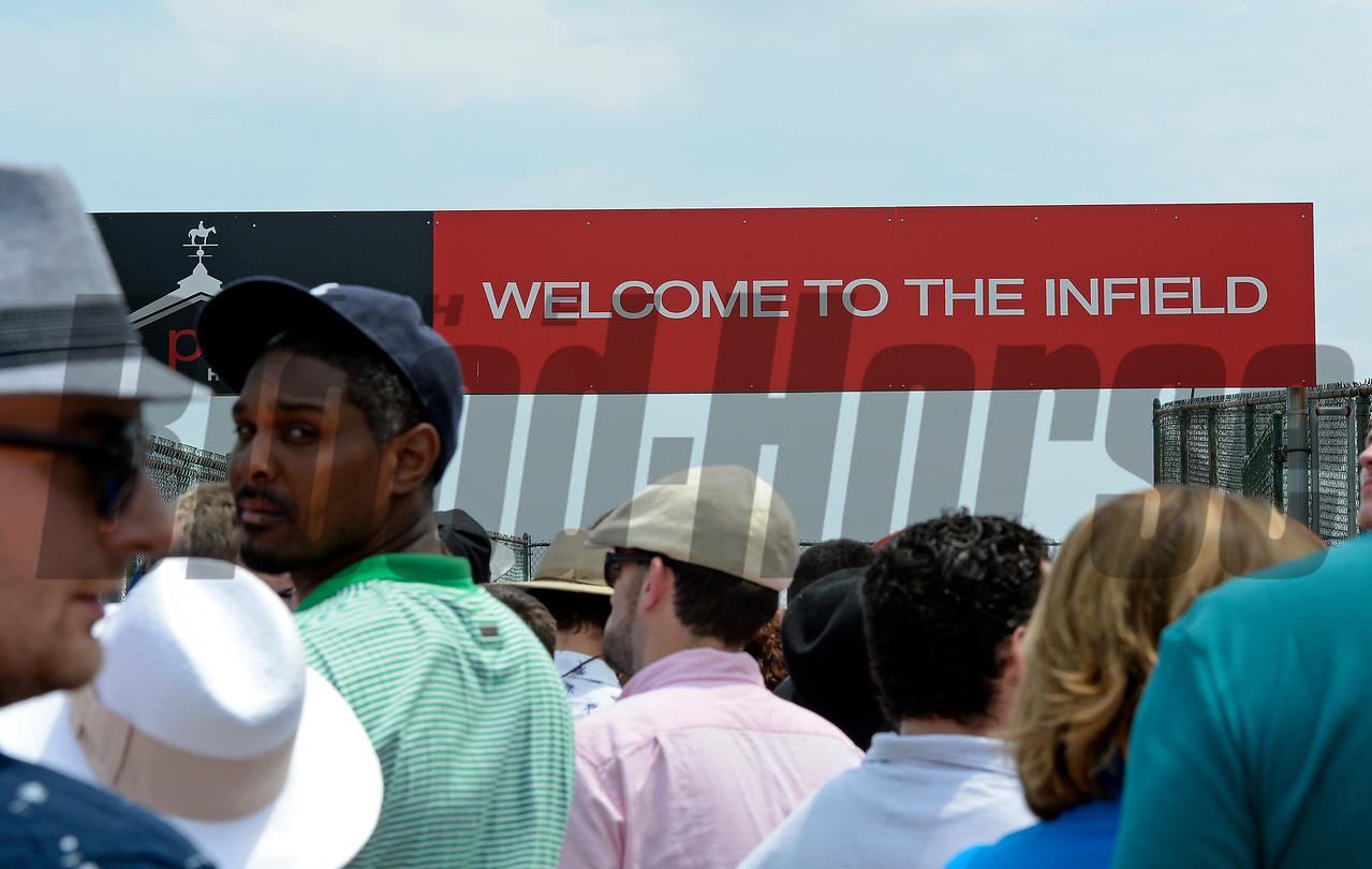 Caption:  scenes, waiting to go into infield<br /> Preakness day on May 16, 2015, at Pimlico in Baltimore, Md.<br /> Scenes5  image955<br /> Photo by Anne M. Eberhardt