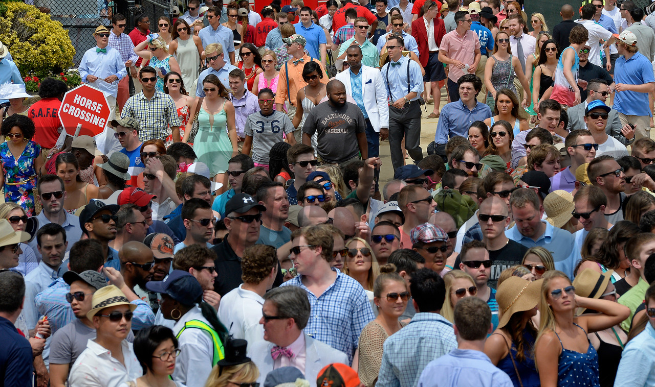 Caption:  scenes, crowd waiting to go into infield<br /> Preakness day on May 16, 2015, at Pimlico in Baltimore, Md.<br /> Scenes5  image948<br /> Photo by Anne M. Eberhardt
