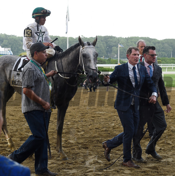 Creator's co-owner Bobby Flay takes him to the winner's circle after winning the 148th running of the Belmont Stakes.    Photo by Skip Dickstein