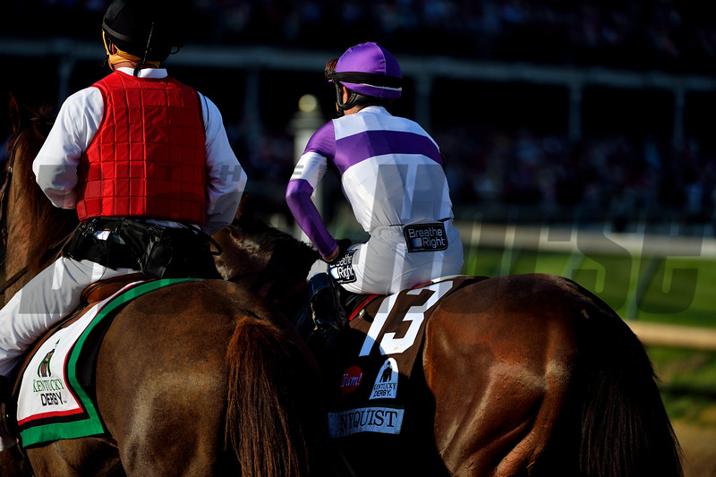 Nyquist and Mario Gutierrez on the post-race parade lap after winning Kentucky Derby 142