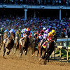 Danzing Candy leads the field of the 142nd Kentucky Derby into the first turn.