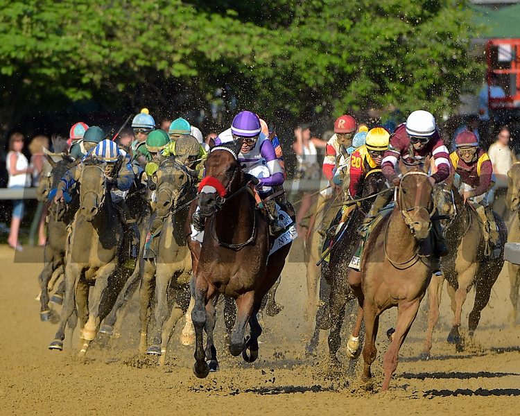 Mario Guiterrez takes  Nyquist (purple cap) past Gun Runner as they turn for home in the Kentucky Derby.